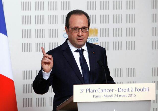France's President Francois Hollande delivers a speech during a visit at the Ligue Contre le Cancer (League Against Cancer) centre in Paris, March 24, 2015.