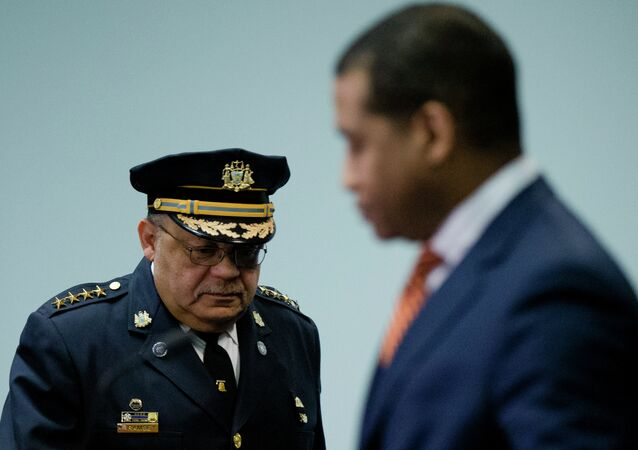 Philadelphia Police Commissioner Charles Ramsey, left, arrive for a news conference Monday, March 23, 2015, in Philadelphia. Poor training has left Philadelphia police officers with the mistaken belief that fearing for their lives alone is justification for using deadly force, the Justice Department said Monday in a review of the city's nearly 400 officer-involved shootings since 2007