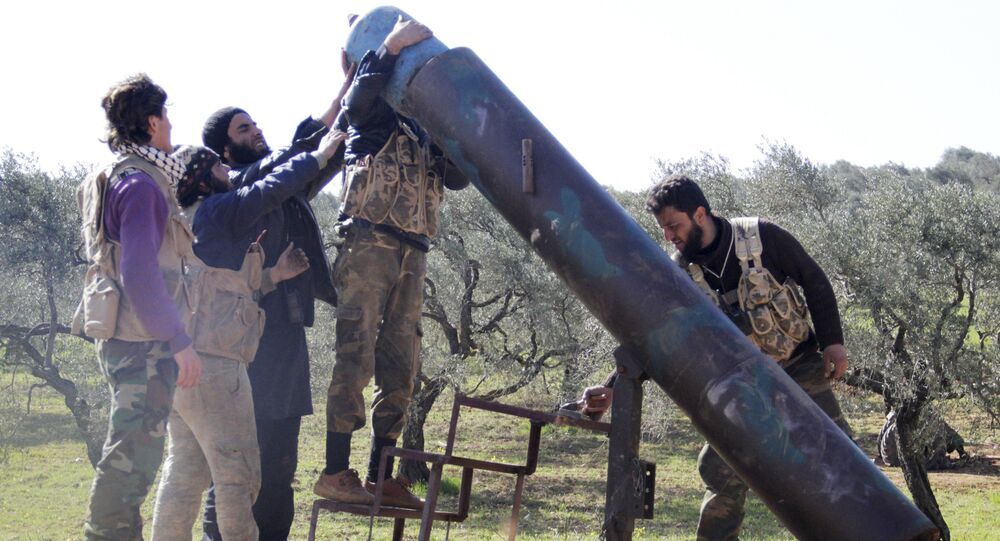 Rebel fighters from Suqour al-Sham Brigade prepare to launch a locally made shell towards forces loyal to Syria's president Bashar Al-Assad who are stationed in checkpoints surrounding the city of Idlib