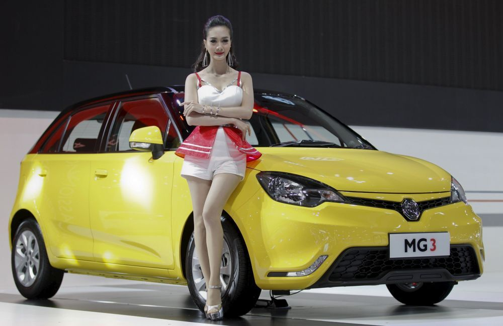 A model poses beside a MG3 during a media presentation of the 36th Bangkok International Motor Show in Bangkok March 24, 2015