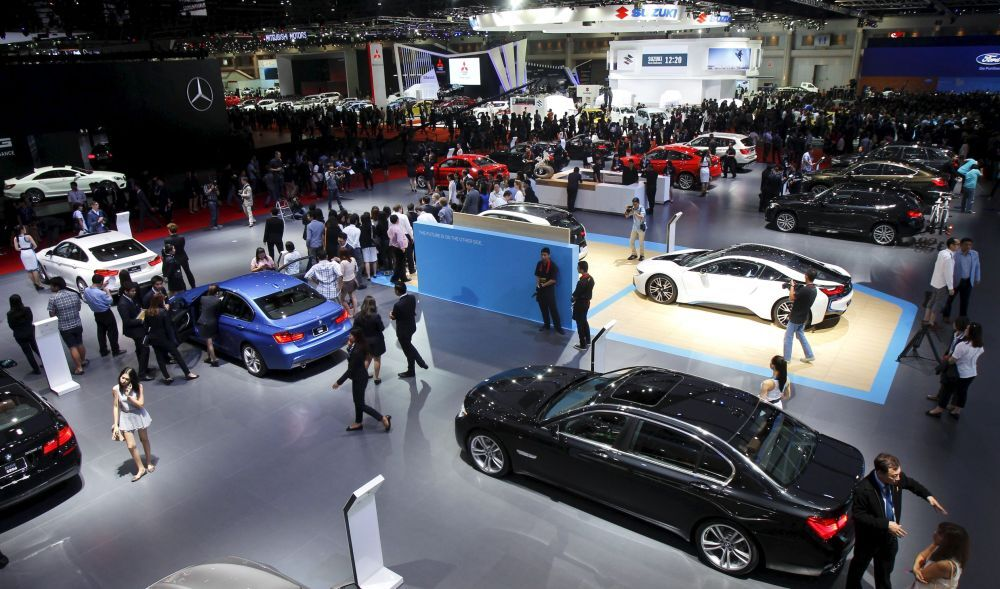 Visitors gather around displays during a media presentation of the 36th Bangkok International Motor Show in Bangkok March 24, 2015