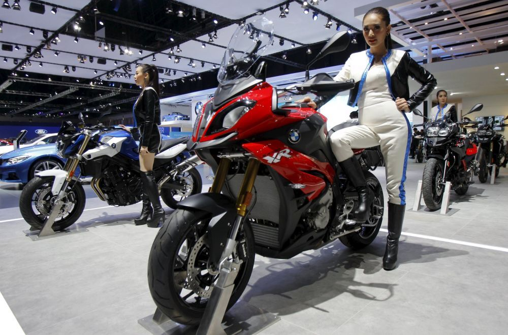 A model poses on a BMW S1000 XR during a media presentation of the 36th Bangkok International Motor Show in Bangkok March 24, 2015