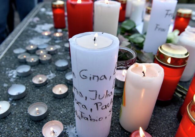 Candles with names of crash victims written on it are placed a table tennis table in front of the Joseph-Koenig Gymnasium in Haltern, western Germany.