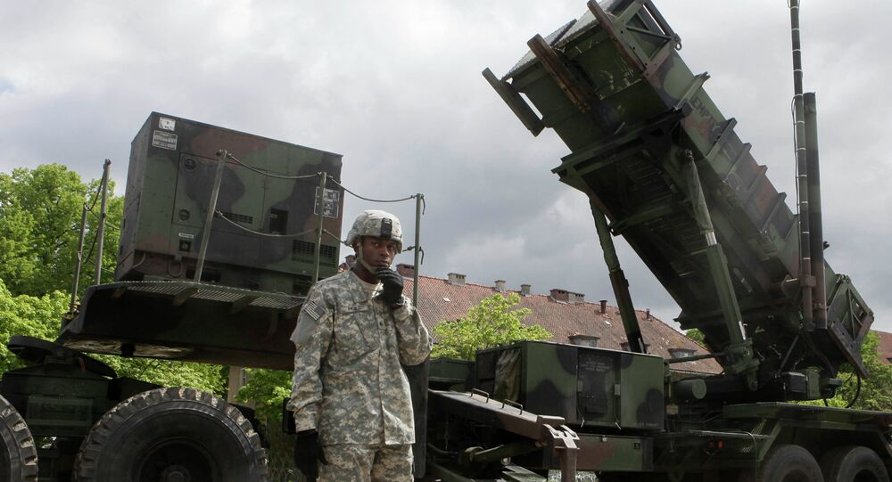 A US soldier stands next to a Patriot surface-to-air missile battery at an army base in Morag, Poland. File photo