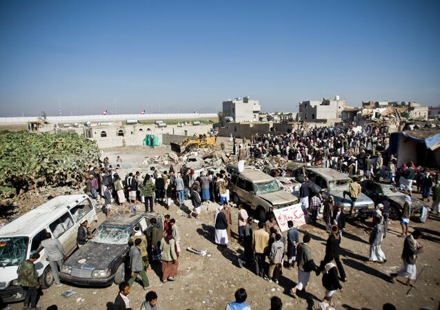 People search for survivors under the rubble of houses destroyed by Saudi airstrikes near Sanaa Airport, Yemen, Thursday, March 26, 2015.