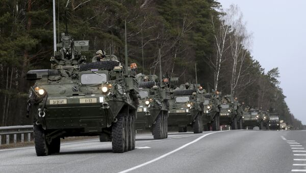 Soldiers of the US Army 2nd Cavalry Regiment deployed in Estonia as a part of the US military's Operation Atlantic Resolve, arrive during the Dragoon Ride exercise in Liepupe March 22, 2015. Operation Atlantic Resolve is aimed at demonstrating commitment to NATO allies in light of Russia's aggression in Ukraine, according to the US Army. - Sputnik International