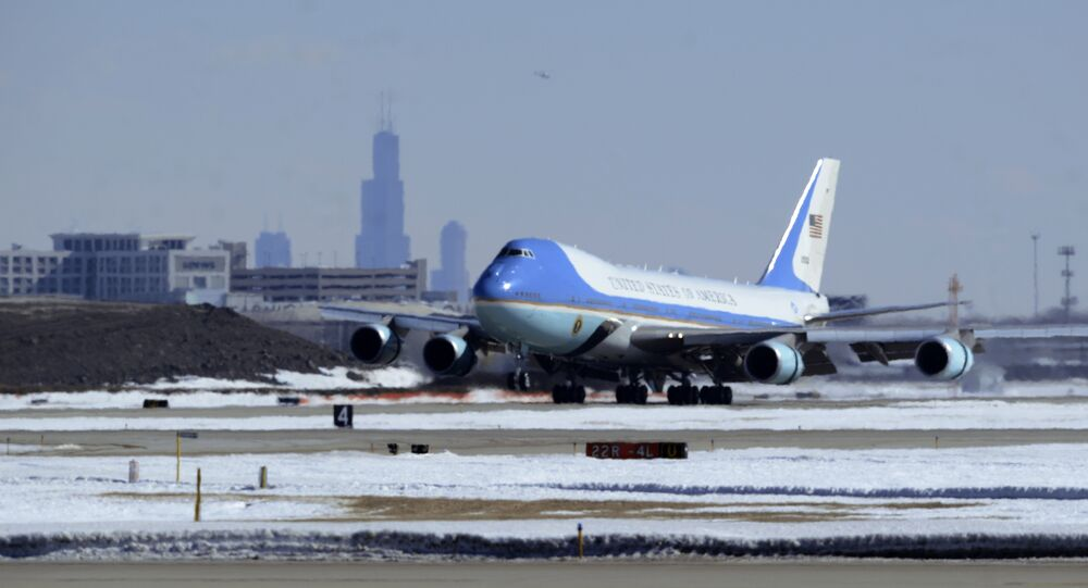Air Force One, with President Barack Obama aboard, lands at O'Hare International Airport in Chicago, Thursday, Feb. 19, 2015.