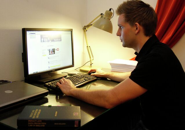 Austrian student Max Schrems sits at his computer, in Vienna, Austria.