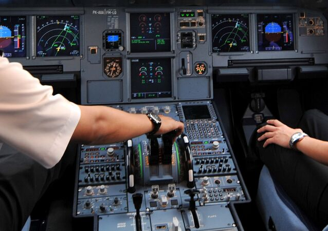 Pilots in the cockpit of an Airbus A320 File photo