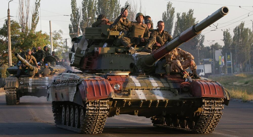 Soldiers from the Ukrainian army ride on tanks in the port city of Mariupol, southeastern Ukraine