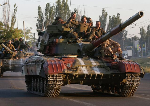 Soldiers of the Ukrainian army ride on tanks