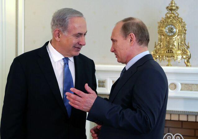 Russia's President Vladimir Putin (R) and Israeli Prime Minister Benjamin Netanyahu speak during their meeting at Putin's residence in the Black Sea resort of Sochi, on May 14, 2013