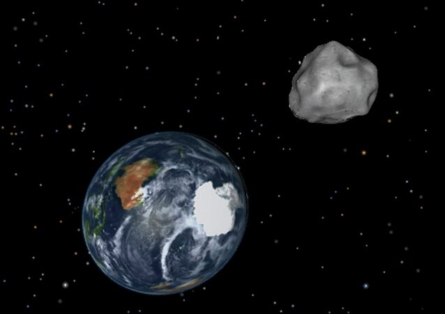 This image provided by NASA/JPL-Caltech shows a simulation of asteroid 2012 DA14 approaching from the south as it passes through the Earth-moon system on Friday, Feb. 15, 2013