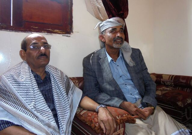 Yemen's Defence Minister General Mahmoud al-Subaihi (R) sits with Governor of the southern province of Lahej, Ahmed al-Majidi in Subaihi's house in al-Subaiha area of Lahej, to which he arrived from the capital Sanaa March 8, 2015