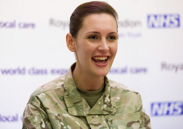Corporal Anna Cross holds a press conference at the Royal Free Hospital in London on March 27, 2015