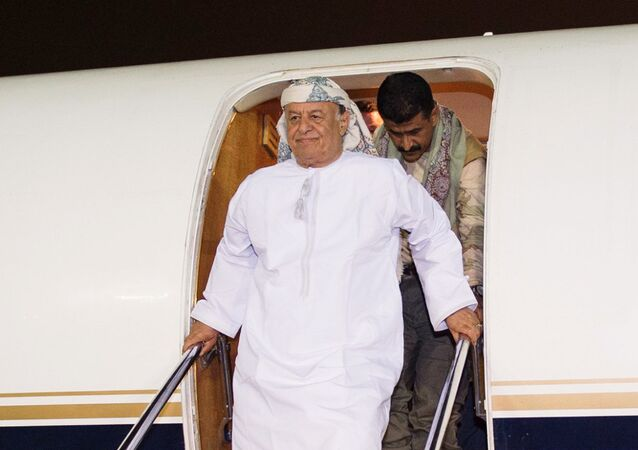 In this photo provided by the Saudi Press Agency (SPA), Yemen's President Abed Rabbo Mansour Hadi gets off an airplane as he arrives at an airbase in Riyadh, Saudi Arabia, Thursday, March 26, 2015