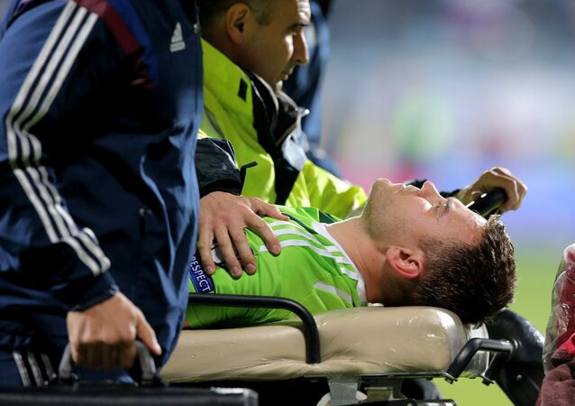 Euro 2016 Group G qualifier between Russia and Montenegro was suspended on Friday after Russian goalkeeper Igor Akinfeev was hit by a flare