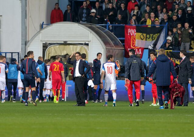 Qualifier between Russia and Montenegro resumed on Friday after a 40-minutes suspension caused by a flare attack by a fan.