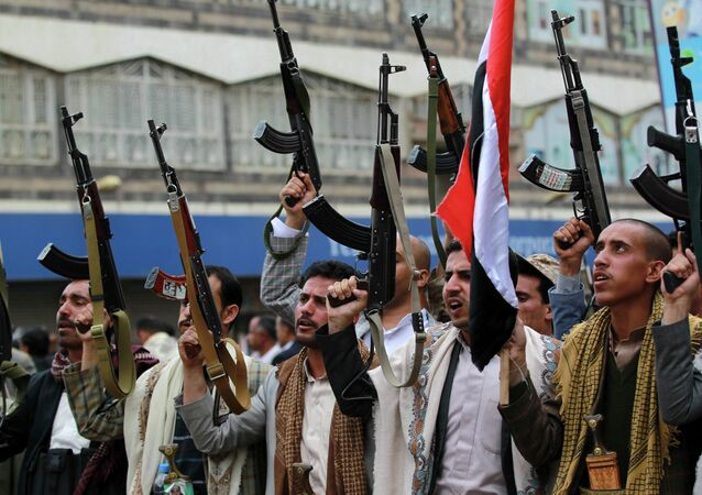 Shiite rebels, known as Houthis, hold up their weapons to protest against Saudi-led airstrikes, during a rally in Sanaa, Yemen, Thursday, March 26, 2015