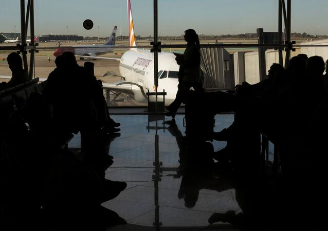 Passengers wait to board a Germanwings flight in Barcelona's El Prat airport March 27, 2015