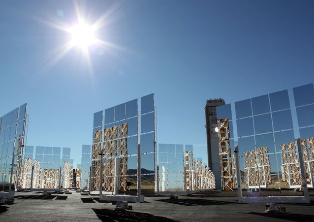 The sun shines above the field of mirrors that make up the National Solar Thermal Test Facility at Sandia National Laboratories in Albuquerque, New Mexico