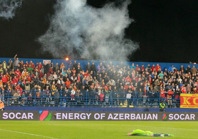 Euro 2016 Group G qualifier between Russia and Montenegro in Podgorica was cancelled after fans launched one more flare attack