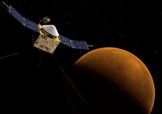 This artist's concept shows the MAVEN spacecraft orbiting Mars.