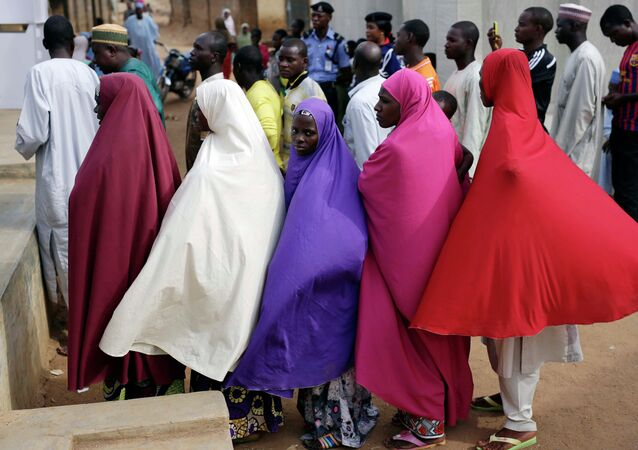 Nigerians wait for to register before voting in Jere, some 60 kilometers (40 miles) from the capital Abuja, Nigeria Saturday, March 28, 2015