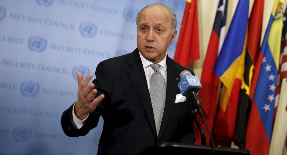 French Foreign Minister Laurent Fabius speaks to members of the media as he stands outside the United Nations Security Council chambers