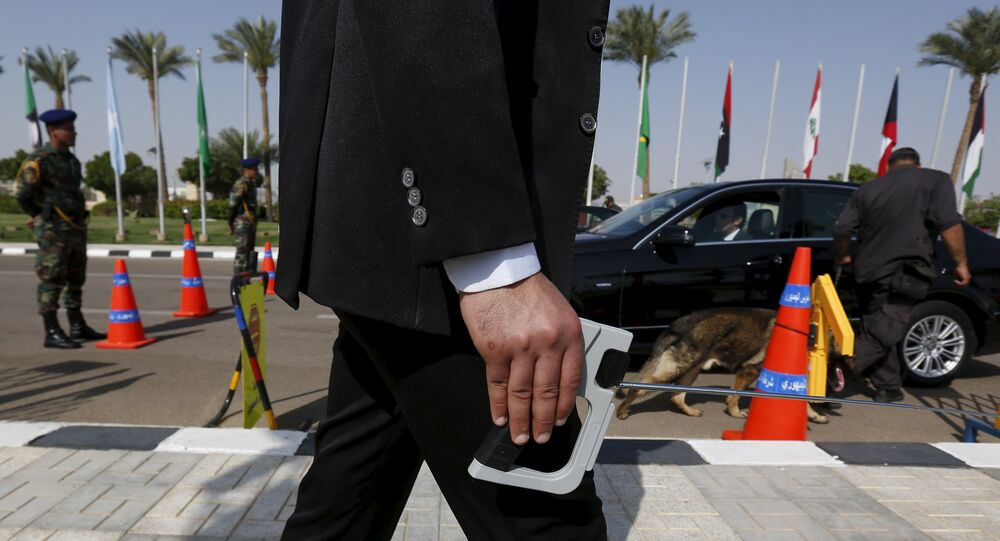 A plainclothes officer from Egypt's Republican Guard conducts a detection of explosive device search for explosives around a car ahead of the Arab Summit in Sharm el-Sheikh, in the South Sinai governorate, south of Cairo, March 28, 2015.