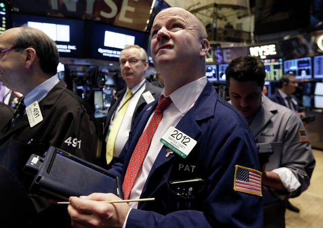 Trader Patrick Casey works on the floor of the New York Stock Exchange