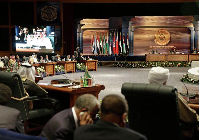 Arab heads of state meet as King Hamad bin Isa Al Khalifa of Bahrain, seen on screen, speaks, in Sharm el Sheik, South Sinai, Egypt, Saturday, March 28, 2015