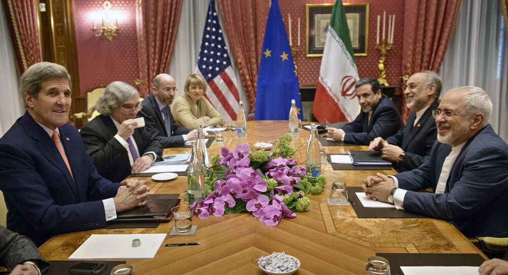 U.S. Secretary of State John Kerry (L), U.S. Secretary of Energy Ernest Moniz (2nd L), the head of the Iranian Atomic Energy Organization Ali Akbar Salehi (2nd R) and Iranian Foreign Minister Javad Zarif (R) wait with others for a meeting at the Beau Rivage Palace Hotel March 28, 2015, in Lausanne