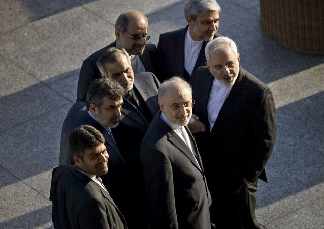 Iranian Foreign Minister Javad Zarif (R) and Head of Iranian Atomic Energy Organization Ali Akbar Salehi stand with other members of their delegation while talking after a meeting with US Secretary of State John Kerry and US officials at the Beau Rivage Palace Hotel in Lausanne March 27, 2015