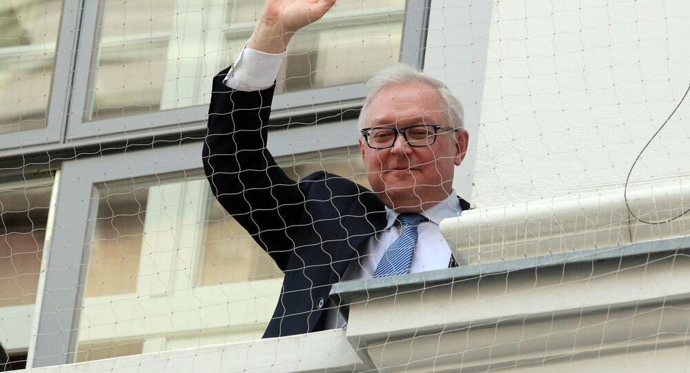 Russian Deputy Foreign Minister Sergei Ryabkov waves from the balcony of Palais Coburg where closed-door nuclear talks with Iran take place in Vienna, Austria, Sunday, Nov.23, 2014