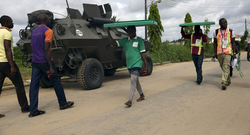 Officials of the Independent National Electoral Commission move electoral materials to the polling booths in Otuoke, Bayelsa State March 28, 2015