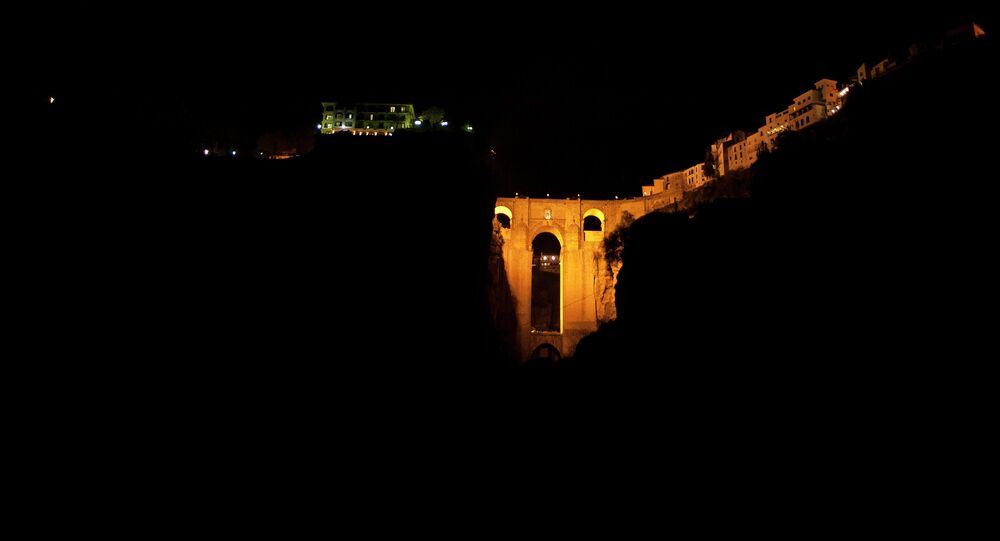 The New Bridge of Ronda is enlightened during the global climate change awareness campaign Earth Hour, on March 28, 2015