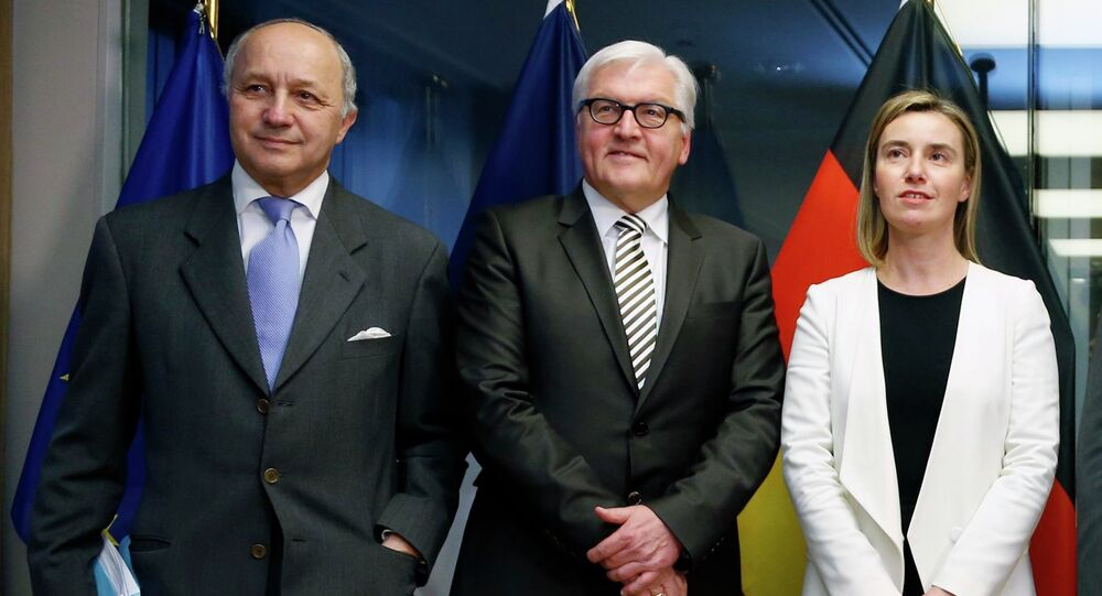 France's Foreign Minister Laurent Fabius (L-R), Germany's Foreign Minister Frank-Walter Steinmeier, European Union foreign policy chief Federica Mogherini pose ahead of nuclear talks in Brussels March 16, 2015