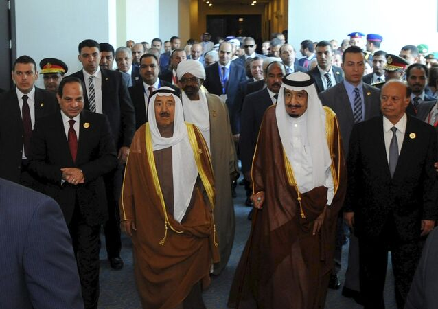 Egyptian President Abdel Fattah al-Sisi (L) stands with Kuwaiti Emir Sheikh Sabah al-Ahmad al-Sabah (2nd L), Saudi King Salman bin Abdulaziz al-Saud (2nd R), and Yemeni President Abd-Rabbu Mansour Hadi (R), during the 26th Arab Summit in Sharm al-Sheikh, in the South Sinai governorate, south of Cairo