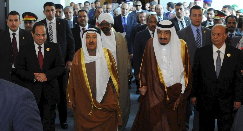 Egyptian President Abdel Fattah al-Sisi (L) stands with Kuwaiti Emir Sheikh Sabah al-Ahmad al-Sabah (2nd L), Saudi King Salman bin Abdulaziz al-Saud (2nd R), and Yemeni President Abd-Rabbu Mansour Hadi (R), during the 26th Arab Summit in Sharm al-Sheikh, in the South Sinai governorate, south of Cairo