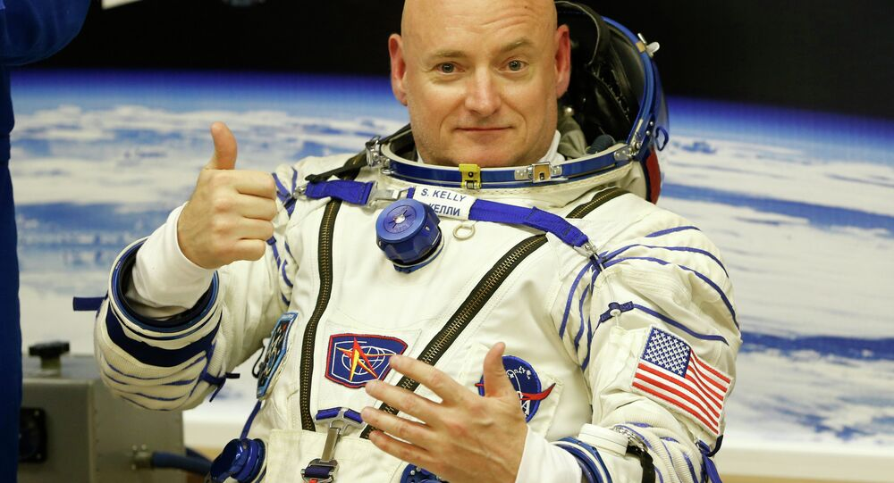 U.S. astronaut Scott Kelly, crew member of the mission to the International Space Station, ISS, gestures prior the launch of a Soyuz-FG rocket at the Russian leased Baikonur cosmodrome, Kazakhstan, Friday, March 27, 2015