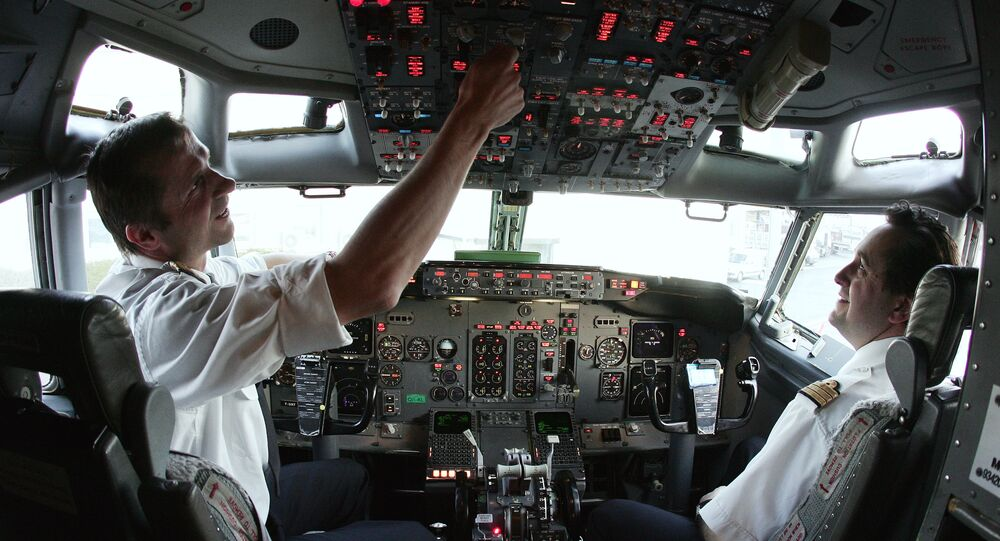 Europe Airpost Boeing B737-300 QC pilot (L) and co-pilot (R) make their pre flight check routine at Paris Roissy airport 21 March 2007