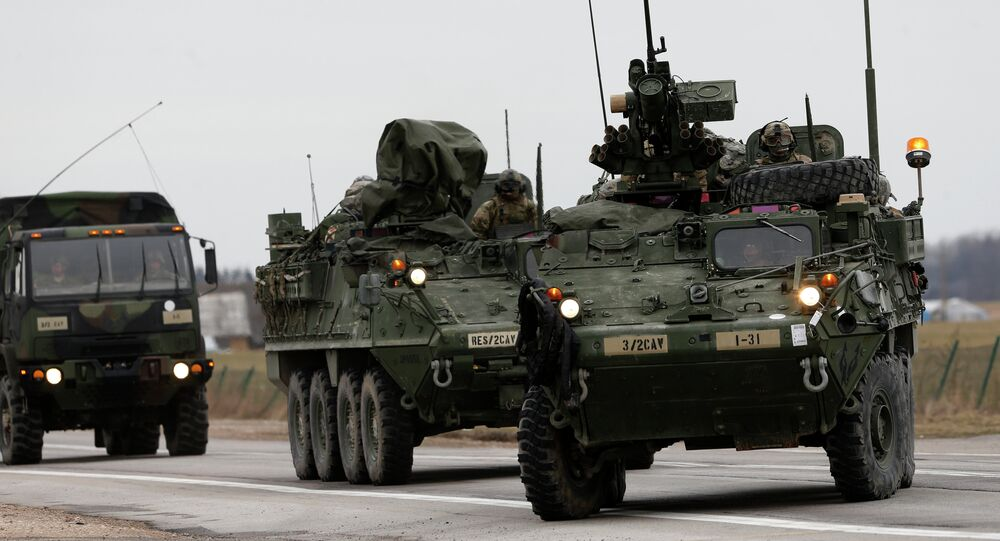 (File) Stryker vehicles of the US Army's 2nd Cavalry Regiment roll down the way during the ''Dragoon Ride'' military exercise in Salociai some 178 kms (110 miles) north of the capital Vilnius, Lithuania, Monday, March 23, 2015