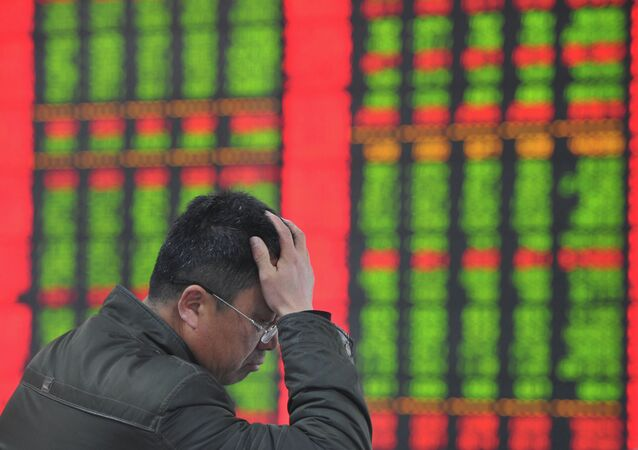 A stock investor gestures as he checks share prices at a securities firm in Fuyang, east China's Anhui province
