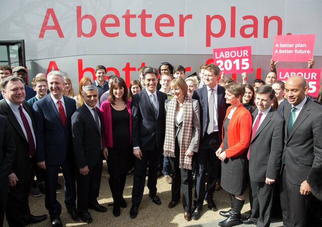 Britain's opposition Labour Party Ed Miliband (C) poses with members of his shadow cabinet to launch his party's 2015 General Election campaign in east London, March 27, 2015