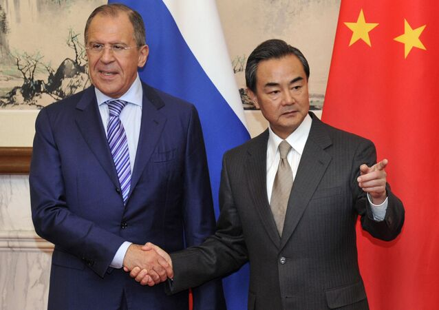 Russian Foreign Minister Sergey Lavrov (L) shakes hands with Chinese Foreign Minister Wang Yi before their meeting at Diaoyutai Guesthouse in Beijing on April 15, 2014