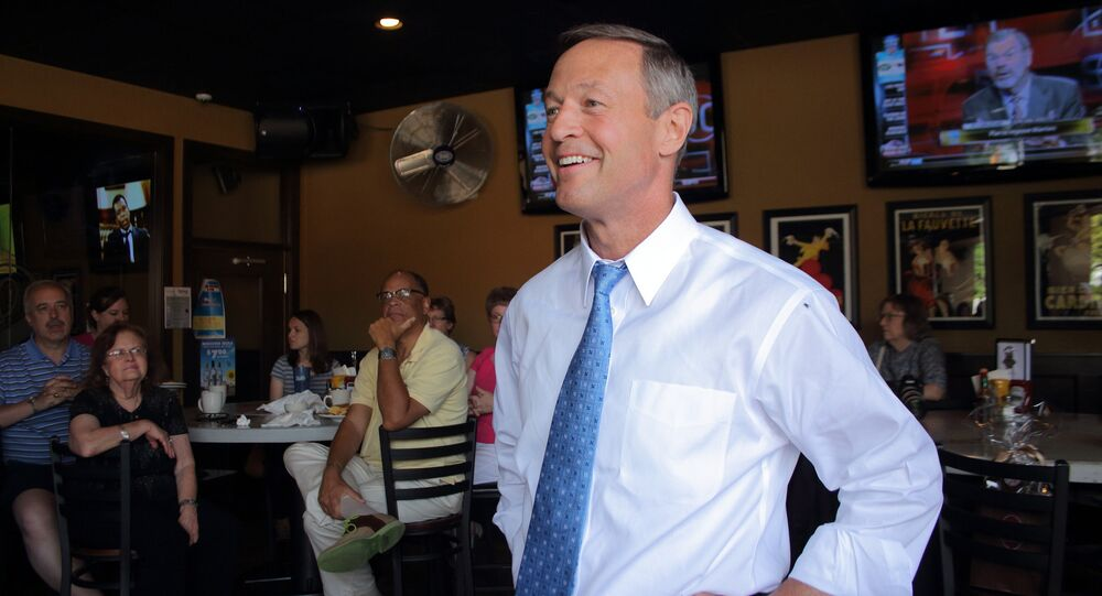 Then-Maryland Governor Martin O'Malley speaks with Democratic activists at Saints Pub and Patio in the Beaverdale neighborhood of Des Moines last year