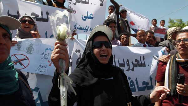 A Yemeni woman shouts slogans during a rally against Saudi-led coalition airstrikes against Huthi rebels on March 29, 2015 in Sanaa - Sputnik International