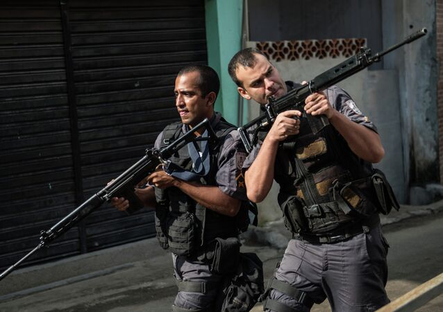 PM militarized police personnel patrol the Chuveirinho favela after an exchange of fire between traffickers and police in the Alemao shantytown complex in Rio de Janeiro, Brazil, on March 24 , 2015