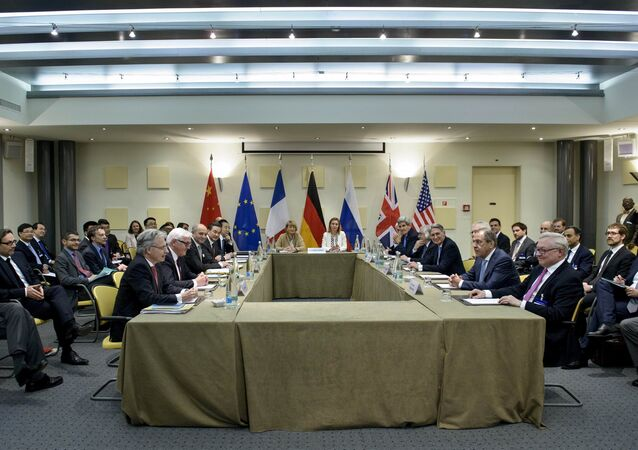 Officials from the P5+1 and the European Union wait for a meeting at the Beau Rivage Palace Hotel in Lausanne, Switzerland March 29, 2015